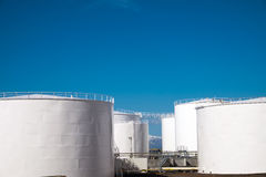 White gas storage tanks Royalty Free Stock Photography