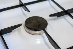 White Gas stove burners in kitchen room. Gas nozzle. No flame royalty free stock image