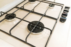 White gas stove with grill closeup Stock Photos