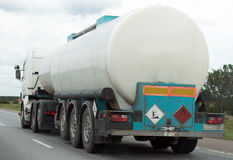 White gas tanker. White gas tanker truck on highway Royalty Free Stock Photography
