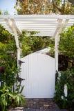 White gate and pergola. White wooden garden gate and pergola Stock Photos