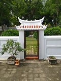 White gate. Shoot from the temple at 4 p.m Stock Photo