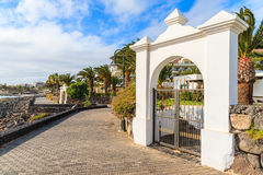 White gate to luxury hotel on coastal promenade Royalty Free Stock Photo