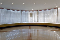 White gauze curtains. White curtain gauzes in the big hall Royalty Free Stock Image