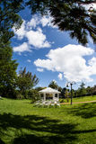 White Gazebo and Chairs. White gazebo with chairs set up for a party or ceremony outdoors Royalty Free Stock Photos
