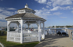 White gazebo by a harbor in the early morning Royalty Free Stock Photography