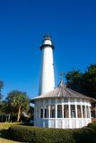 White Gazebo and Lighthouse Under Clear Blue Sky Royalty Free Stock Images