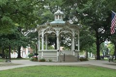 White gazebo in a park stock photo