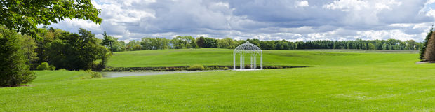White Gazebo by a Pond #4 Stock Image