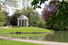 White gazebo on the shore of the pond in the park Stock Photography
