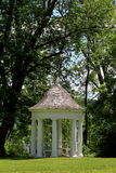 White gazebo under trees Royalty Free Stock Photos