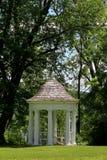 White gazebo under trees Royalty Free Stock Photos
