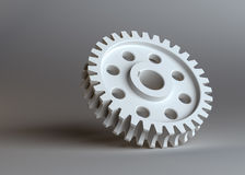 White gear on grey studio background Stock Images