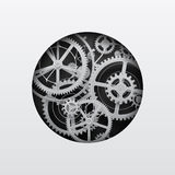 White gear wheels in the cut round hole on black Royalty Free Stock Photos