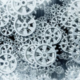 White gears and cogs macro. On black background. 3D Stock Image