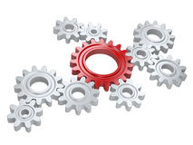 White gears and one red. Teamwork and leadership concept. Royalty Free Stock Photo