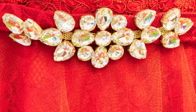 White gems on red lace Stock Image