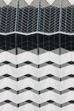 White Geometric Building. A white building in downtown with stark geometric shapes and lines. Naturally high contrast portrays a strong presence stock photography