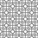 White geometrical ornament perforated with gray Stock Photos