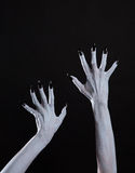 White ghost or witch hands with sharp black nails, body art Stock Photos