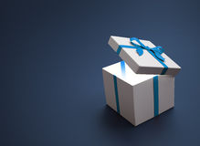 White gift with a blue ribbon Royalty Free Stock Image