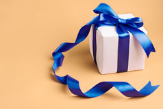 White gift with blue ribbon Royalty Free Stock Photography