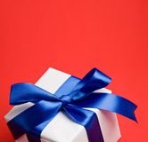 White gift with a blue ribbon. royalty free stock photography