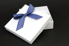 White gift with blue ribbon Royalty Free Stock Images