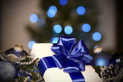 White gift with blue ribbons Stock Images