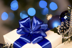 White gift with blue ribbons Royalty Free Stock Images
