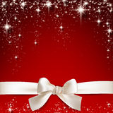 White gift bow on red. Stock Images