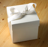 White Gift Box. On table wooden Stock Images