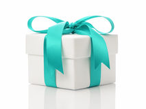 White gift box with azure ribbon bow Royalty Free Stock Images