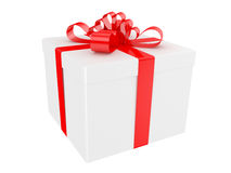 White gift box with big red holiday bow Stock Photos
