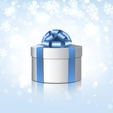White gift box with a blue bow. Stock Photos