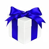 White gift box with blue bow and ribbon on white Royalty Free Stock Image