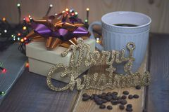 White gift box, blue cup, the inscription Marry Christmas stock photo