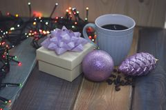 White gift box, blue cup, pink Christmas tree decorations n Royalty Free Stock Images