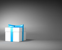 White Gift Box with Blue Ribbon and Bow on the Gray Background. Space for Text Stock Image