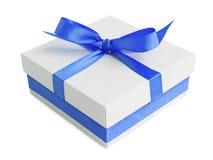 White gift box with blue satin ribbon bow. Isolated on white Stock Photos