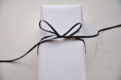 White gift box with bow Royalty Free Stock Photos