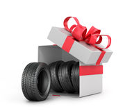 White Gift Box with car tires. Isolated on a white background Stock Images
