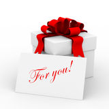 White gift box with a card. Royalty Free Stock Image