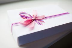 White gift box with color ribbon Stock Image