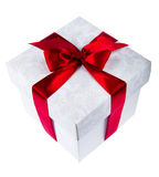 White gift box decorated with red ribbon Stock Photos