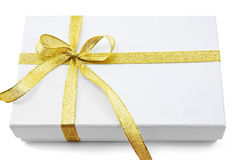 White gift box with gold ribbon Stock Photography