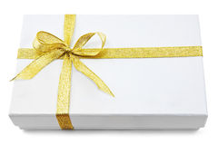 White gift box with gold ribbon Royalty Free Stock Photo