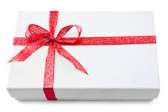 White gift box with gold ribbon Stock Image