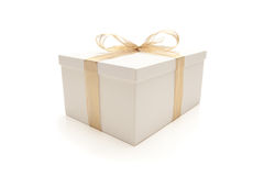 White Gift Box with Gold Ribbon Isolated Stock Photography