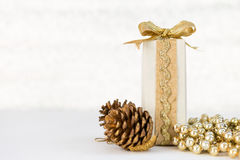 White gift box with gold ribbon on white background Royalty Free Stock Photography